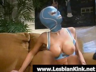 sexy lesbo in rubber mask sucking a biggest toy