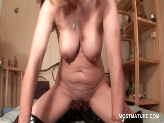 perverted mature in glasses working her old cunt