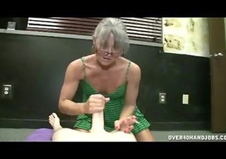 mature lady gives cook jerking while smokin