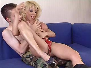 older woman donna checks young soldier s skills
