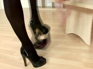 aged lady thrashing honey in stocking