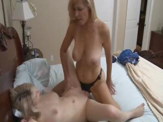 hawt blonde cougar mama uses a strapon to bang