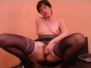 older dame with short hair in dark stockings