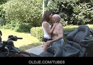 youthful russian girl rides truly old man