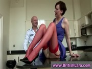 older lady instructs amateur about nylons