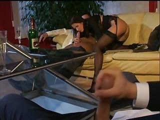 sexy older hottie gets busy with a couple of hard
