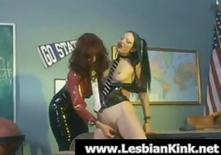lesbian in latex acquires twat toyed by a redhead