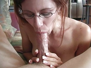 mature redhead momma with glasses doing deep face