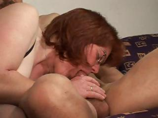 older redhead gets her love tunnel munched,