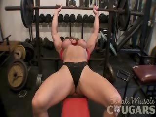 mature muscular woman plays with big love button
