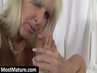mature licking her own toes and feet