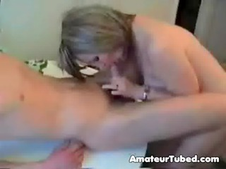 mature mamma and son in kitchen