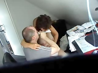 lewd dark brown secretary gets caught on spy