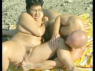 granny gets group-fucked at the beach