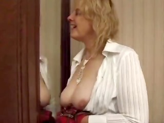 french oldie stuffs her panties in her pussy and
