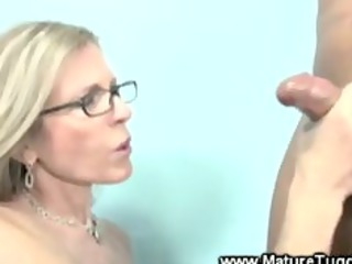 mature blond spex giving a cook jerking
