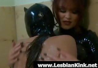 lesbos in latex toying slits in washroom tub