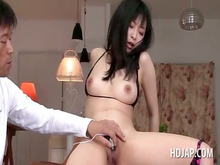 superb asian babe acquires muff and mouth dildo
